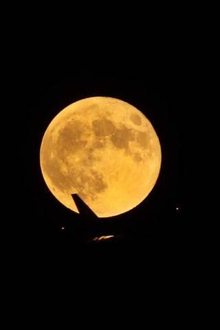 150930スーパームーンと飛行機.jpg